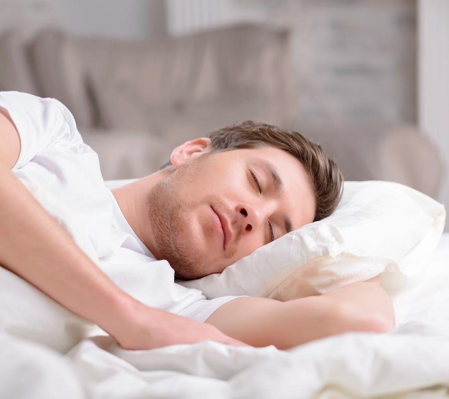 bigstock-Handsome-guy-sleeps-in-his-bed-107391704