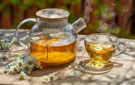 bigstock-Herbal-chamomile-tea-and-chamo-384666440