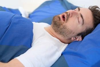 bigstock-Man-In-Bed-Suffering-For-Sleep-214312441