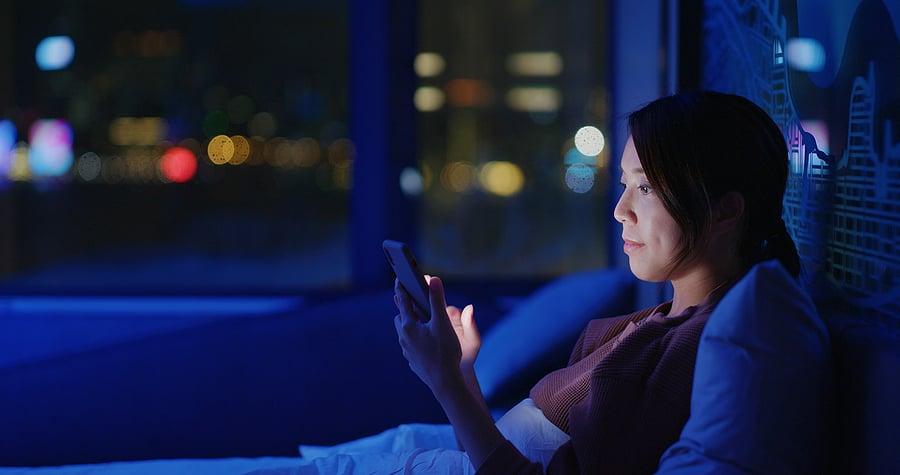 bigstock-Woman-use-of-smart-phone-on-be-415847599
