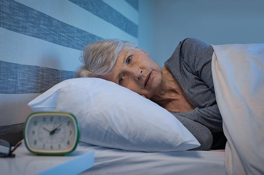 bigstock-Worried-senior-woman-in-bed-at-257179510