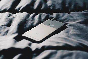 phone in bed sheets
