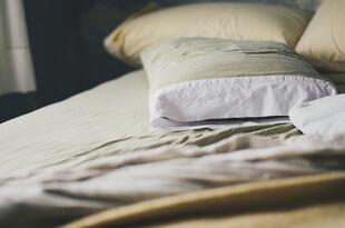 pillows on beige bed