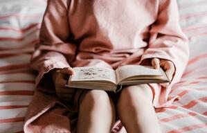 woman reading on bed