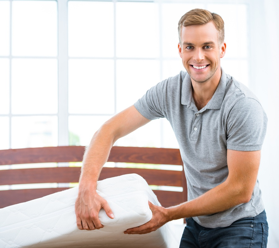 bigstock-Young-man-near-white-bed-112280666.jpg